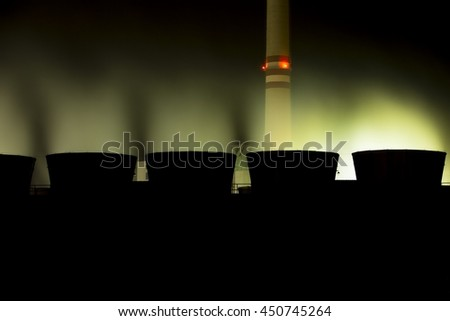 view of cooling towers coal power plant  at night  - stock photo