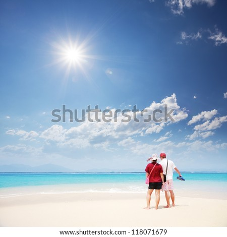 view of couple look at sea