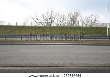 View of crash barrier on highway - stock photo