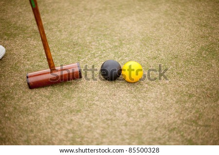 View of Croquet mallet and balls in action
