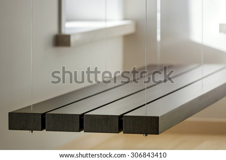 View of custom suspended bench in light interior - stock photo