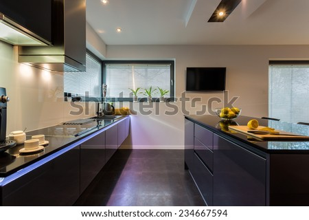 View of dark furniture in white painted kitchen - stock photo