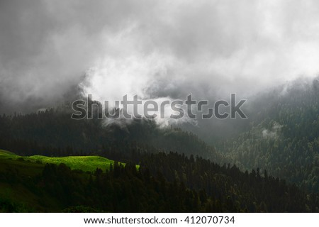 View of dark mountain forest landscape nature in clouds. Wild nature. Nature landscape & sun. Nature. Beautiful nature. Green nature. Nature life. Nature Nature view. Great nature. Dark nature. Nature - stock photo