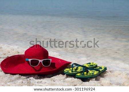 View of Dead Sea coastline. Slippers on the shore - stock photo