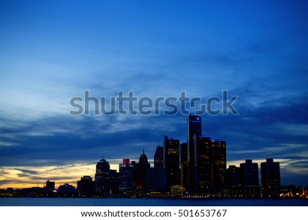 View of Detroit city skyline at dusk with building silhouettes