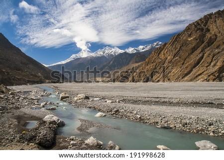 view of Dhaulagiri from the river Gandaki  - stock photo