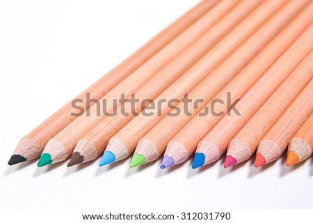 View of different color pencils isolated on the white background. Drawing supplies: assorted color pencils, isolated on white background. Abstract background from color pencils. - stock photo