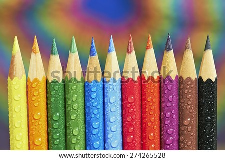 View of different colored crayons on colored background - stock photo