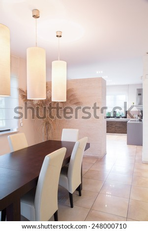 View of dining room connected with kitchen - stock photo