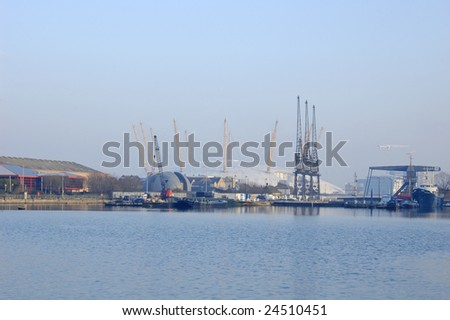 View of docks and the Millennium Dome from Canary Wharf in London, England - stock photo