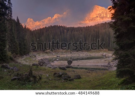 View of Dolomites (Italian Alps) at sunset near Karersee lake (Lago di Carezza).