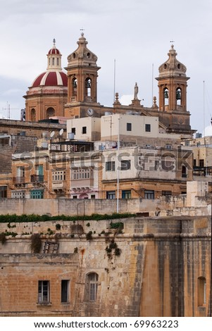 View of dome and clock towers of  St. Lawrennce Cathedral at Vittoriosa. Malta - stock photo