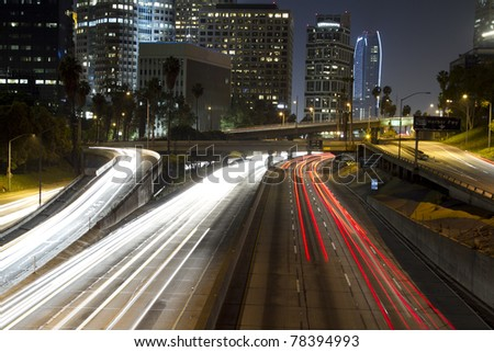view of downtown los angeles and freeways at night - stock photo