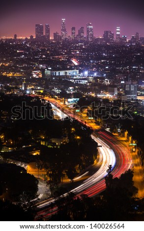 View of Downtown Los Angeles from the Hollywood Hills.  Interstate 101 is shown in the foreground. - stock photo