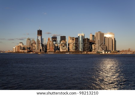 view of downtown manhattan at dusk from the Staten island ferry, new york city, America - stock photo