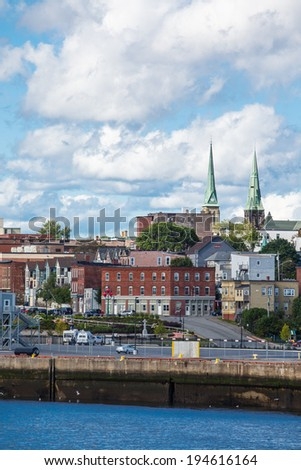 View of downtown St Johns, Newfoundland in Canada from the sea - stock photo