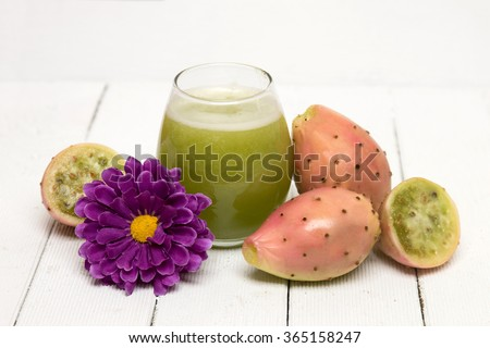 View of drinkable juice made from opuntia ficus-indica cactus fruits on a white background