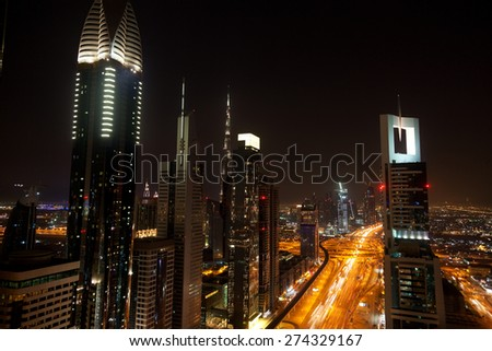 View of Dubai skyline at night from 42th floor terrace of Four Points Sheraton Hotel at Sheikh Zayed Road