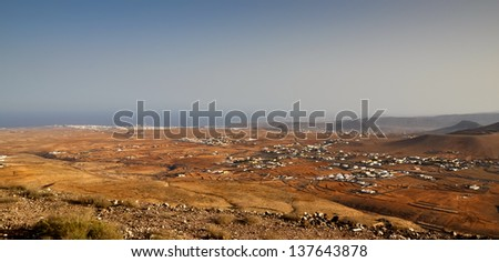 View of eastern Fuerteventura coast and Puerto del Rosario - its capital town. - stock photo