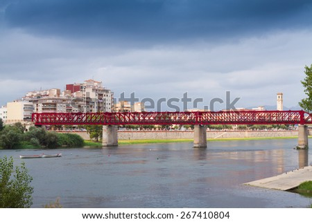 View of Ebre river with Ferrocarril bridge. Tortosa, Spain - stock photo