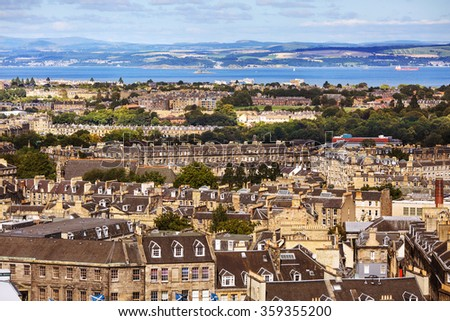 View of Edinburgh city buildings with hills in the background.  - stock photo