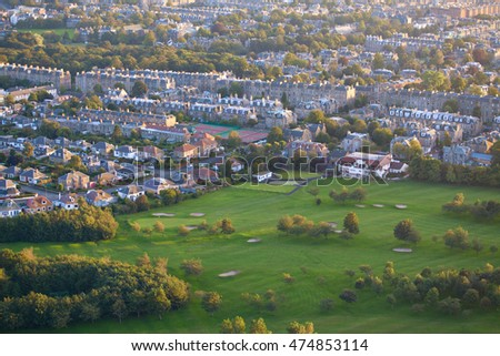 View of Edinburgh Prestonfield Golf Club course and town houses from Arthur's Seat peak.