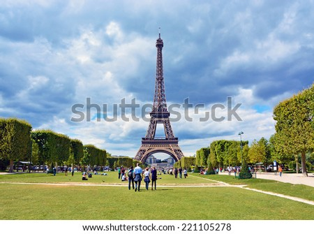 View of Eiffel Tower from Champ de Mars before the storm. Paris, France - stock photo