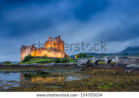 View of Eilean Donan castle at sunset, Scotland, United Kingdom - stock photo