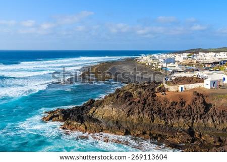 View of El Golfo village and blue ocean on coast of Lanzarote island, Spain - stock photo