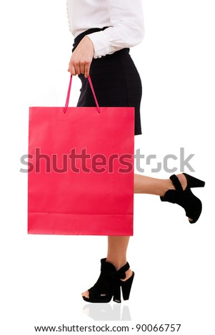 View of elegant woman carrying red shopping bag