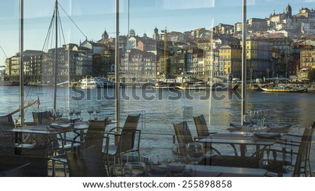 View of embankment Ribeira in old town of Porto from the restaurant window, Portugal. - stock photo