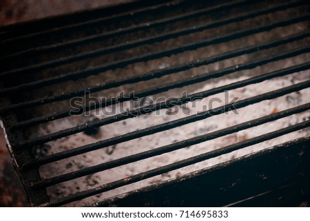 View of empty dirty charcoal grill. Dark tone.