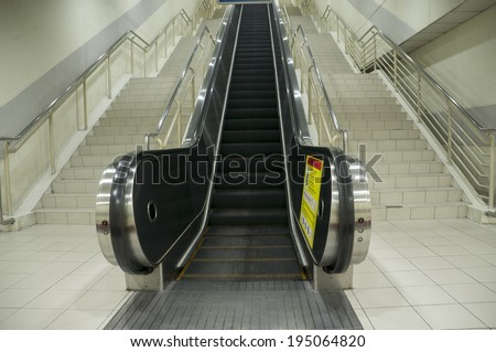 View of empty escalator at train station - stock photo