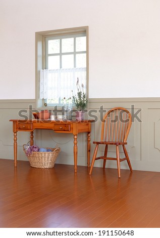 View of empty room with wooden table and chair  - stock photo