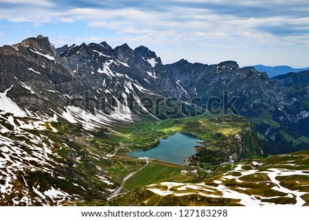 View of Engelberg valley and lake Trubsee from Mount Titlis, Switzerland. - stock photo