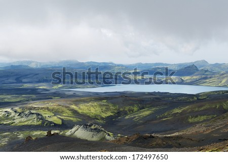View of eruption craters and lakes at Lakagigar area on a cloudy day, Iceland - stock photo