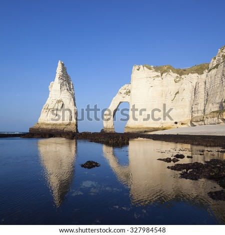 View of Etretat Aval cliff and blue ocean. Normandy, France, Europe. - stock photo