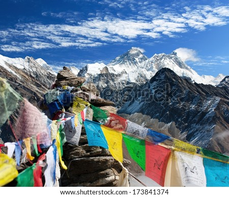 view of everest from gokyo ri with prayer flags - Nepal  - stock photo