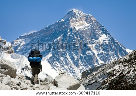 view of Everest from Gokyo valley with tourist on the way to Everest base camp, Sagarmatha national park, Khumbu valley, Nepalese Himalayas - stock photo