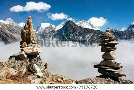 view of everest with stone mans from gokyo ri - stock photo