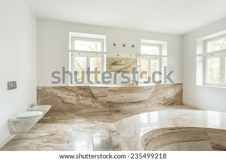 View of expensive bathroom with marble floor