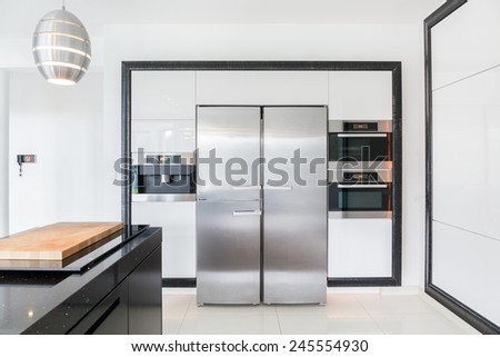 View of expensive kitchen in modern house - stock photo