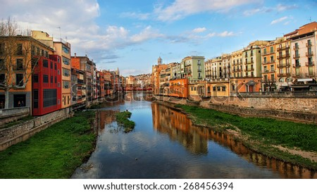View of famous Catalonia city Girona, Spain with canal, cathedral and historic colorful houses - stock photo