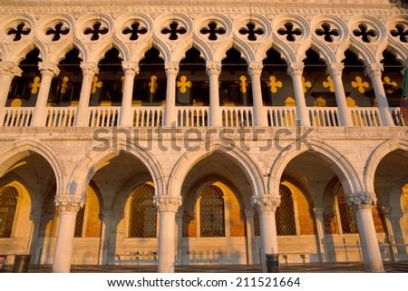 View of famous Dodge Palace  in perfect sunrise light which is creating  yellow shadow pattern, Venice Italy - stock photo