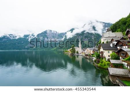 view of famous Hallstatt mountain village with Hallstaetter Lake in the Austrian Alps, region of Salzkammergut, Austria - stock photo
