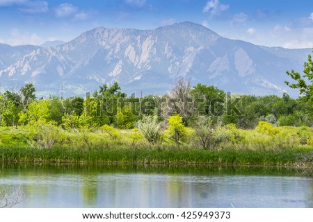 View of Flatirons from Walden Pond in Boulder Colorado