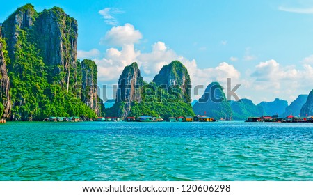 View of floating village and rock islands in Halong Bay, Vietnam, Southeast Asia - stock photo