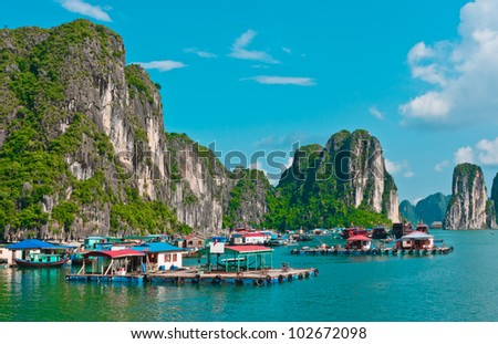 View of floating village in Halong Bay, Vietnam, Southeast Asia - stock photo