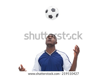 View of football player playing over white background