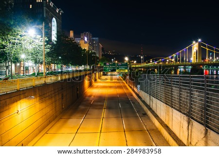 View of Fort Duquesne Boulevard at night, in Pittsburgh, Pennsylvania. - stock photo